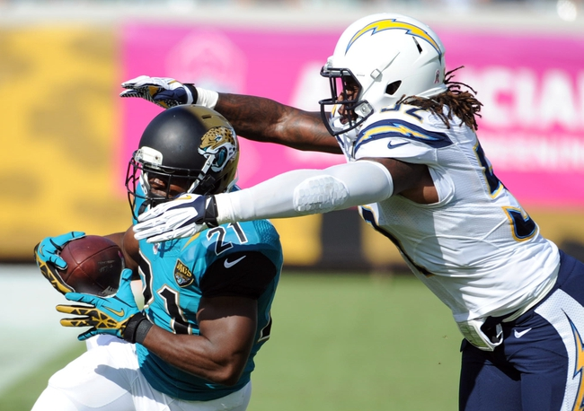 Oct 20, 2013; Jacksonville, FL, USA; Jacksonville Jaguars running back Justin Forsett (21) tries to run past San Diego Chargers inside linebacker Reggie Walker (52) during the second half of the game at EverBank Field. Mandatory Credit: Melina Vastola-USA TODAY Sports