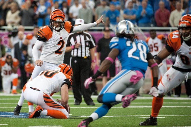 Oct 20, 2013; Detroit, MI, USA; Cincinnati Bengals kicker Mike Nugent (2) kicks the game winning field goal during the fourth quarter against the Detroit Lions at Ford Field. Bengals won 27-24. Mandatory Credit: Tim Fuller-USA TODAY Sports