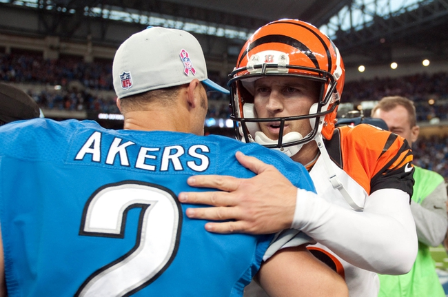Oct 20, 2013; Detroit, MI, USA; Detroit Lions kicker David Akers (2) congratulates Cincinnati Bengals kicker Mike Nugent (2) after the game at Ford Field. Bengals won 27-24. Mandatory Credit: Tim Fuller-USA TODAY Sports