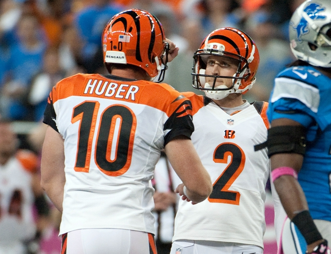 Oct 20, 2013; Detroit, MI, USA; Cincinnati Bengals kicker Mike Nugent (2) celebrates with punter Kevin Huber (10) after kicking the game winning field goal during the fourth quarter against the Detroit Lions at Ford Field. Bengals won 27-24. Mandatory Credit: Tim Fuller-USA TODAY Sports