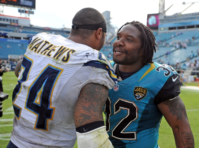 Oct 20, 2013; Jacksonville, FL, USA; San Diego Chargers running back Ryan Mathews (24) talks to Jacksonville Jaguars running back Maurice Jones-Drew (32) after the game at EverBank Field. Mandatory Credit: Melina Vastola-USA TODAY Sports