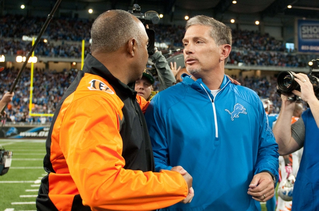 Oct 20, 2013; Detroit, MI, USA; Cincinnati Bengals head coach Marvin Lewis (left) and Detroit Lions head coach Jim Schwartz (right) shake hands after the game at Ford Field. Bengals won 27-24. Mandatory Credit: Tim Fuller-USA TODAY Sports