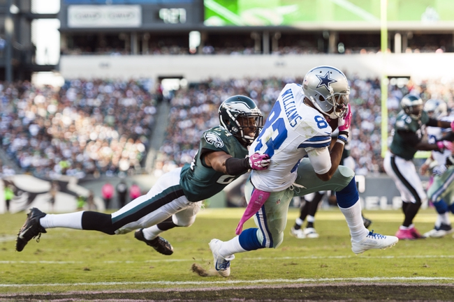 Oct 20, 2013; Philadelphia, PA, USA; Dallas Cowboys wide receiver Terrance Williams (83) scores a touchdown as Philadelphia Eagles cornerback Bradley Fletcher (24) defends during the fourth quarter at Lincoln Financial Field. Mandatory Credit: Howard Smith-USA TODAY Sports