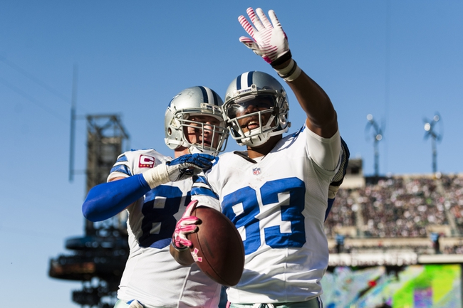 Oct 20, 2013; Philadelphia, PA, USA; Dallas Cowboys wide receiver Terrance Williams (83) celebrates scoring a touchdown with tight end Jason Witten (82) during the fourth quarter against the Philadelphia Eagles at Lincoln Financial Field. Mandatory Credit: Howard Smith-USA TODAY Sports