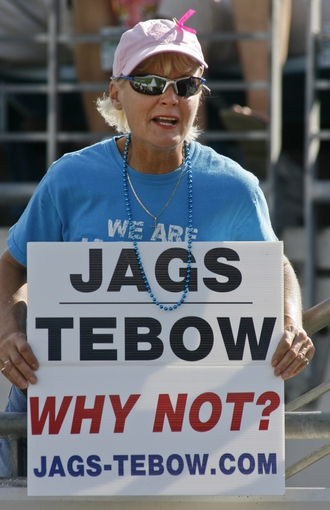 Oct 20, 2013; Jacksonville, FL, USA; A Jacksonville Jaguars fan holds a sign that refers to former NFL quarterback Tim Tebow (not pictured) in the fourth quarter of their game against the San Diego Chargers at EverBank Field. The San Diego Chargers defeated the Jacksonville Jaguars 24-6. Mandatory Credit: Phil Sears-USA TODAY Sports