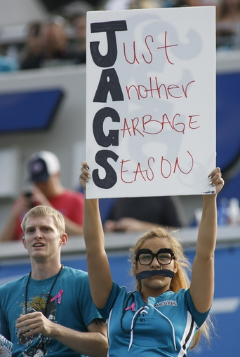 Oct 20, 2013; Jacksonville, FL, USA; A Jacksonville Jaguars fan holds up a sign at the end of the fourth quarter of their game against the San Diego Chargers at EverBank Field. The San Diego Chargers defeated the Jacksonville Jaguars 24-6. Mandatory Credit: Phil Sears-USA TODAY Sports