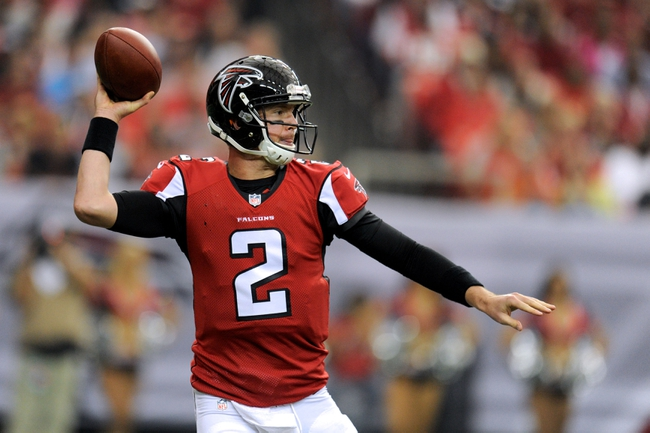 Oct 20, 2013; Atlanta, GA, USA; Atlanta Falcons quarterback Matt Ryan (2) passes against the Tampa Bay Buccaneers during the second half at the Georgia Dome. The Falcons defeated the Buccaneers 31-23.  Mandatory Credit: Dale Zanine-USA TODAY Sports