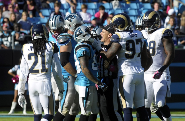 Oct 20, 2013; Charlotte, NC, USA; St. Louis Rams defensive end Eugene Sims (right) has words with Carolina Panthers wide receiver Steve Smith (left)  during the game at Bank of America Stadium. Panthers win 30-15. Mandatory Credit: Sam Sharpe-USA TODAY Sports