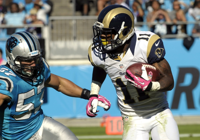 Oct 20, 2013; Charlotte, NC, USA; St. Louis Rams punt returner Tavon Austin (11) runs past Carolina Panthers linebacker Jordan Senn (57) on a punt return during the game at Bank of America Stadium. Panthers win 30-15. Mandatory Credit: Sam Sharpe-USA TODAY Sports