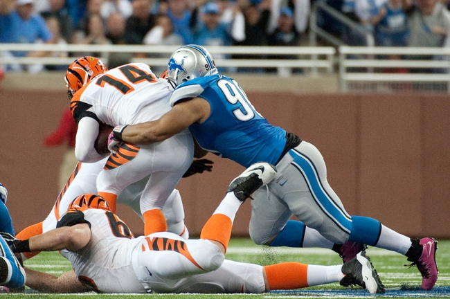 Oct 20, 2013; Detroit, MI, USA; Detroit Lions defensive tackle Ndamukong Suh (90) sacks Cincinnati Bengals quarterback Andy Dalton (14) during the fourth quarter at Ford Field. Bengals won 27-24. Mandatory Credit: Tim Fuller-USA TODAY Sports