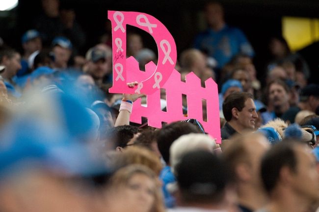 Oct 20, 2013; Detroit, MI, USA; Detroit Lions fans hold a defense sign during the game against the Cincinnati Bengals at Ford Field. Bengals won 27-24. Mandatory Credit: Tim Fuller-USA TODAY Sports