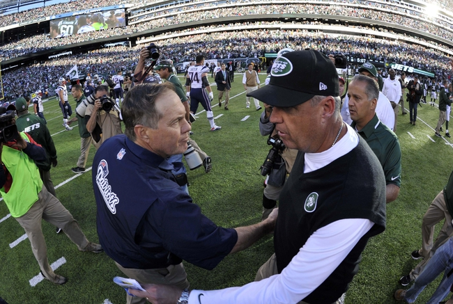 Oct 20, 2013; East Rutherford, NJ, USA; New York Jets head coach Rex Ryan (right) and New England Patriots head coach Bill Belichick shake hands after the game at MetLife Stadium. The Jets won the game 30-27 in overtime. Mandatory Credit: Joe Camporeale-USA TODAY Sports