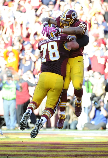Oct 20, 2013; Landover, MD, USA; Washington Redskins running back Roy Helu (29) is congratulated by Washington Redskins guard Kory Lichtensteiger (78) after scoring a touchdown against the Chicago Bears during the second half at FedEX Field. Mandatory Credit: Brad Mills-USA TODAY Sports