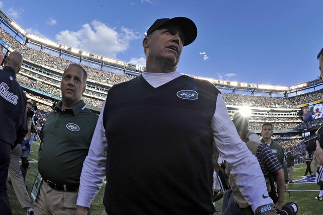 Oct 20, 2013; East Rutherford, NJ, USA; New York Jets head coach Rex Ryan leaves the field after defeating the New England Patriots at MetLife Stadium. The Jets won the game 30-27 in overtime. Mandatory Credit: Joe Camporeale-USA TODAY Sports