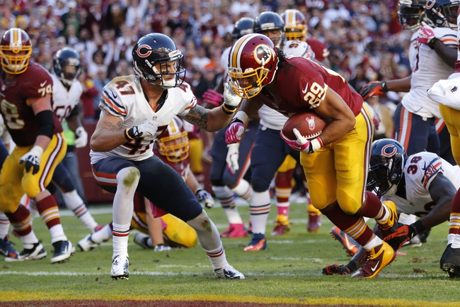 Oct 20, 2013; Landover, MD, USA; Washington Redskins running back Roy Helu (29) carries the ball past Chicago Bears free safety Chris Conte (47) to score the game winning touchdown in the final minute against the Chicago Bears at FedEx Field. The Redskins won 44-41. Mandatory Credit: Geoff Burke-USA TODAY Sports