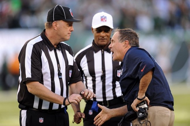 Oct 20, 2013; East Rutherford, NJ, USA; New England Patriots head coach Bill Belichick argues a personal foul call against his team by officials which ultimately led to a New York Jets game winning field goal during overtime at MetLife Stadium. The Jets won the game 30-27 in overtime. Mandatory Credit: Joe Camporeale-USA TODAY Sports