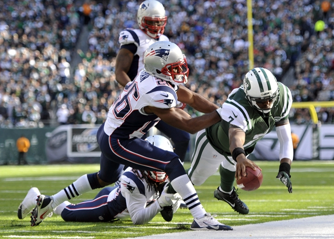 Oct 20, 2013; East Rutherford, NJ, USA; New York Jets quarterback Geno Smith (7) dives for a first down against the New England Patriots during the second half at MetLife Stadium. The Jets won the game 30-27 in overtime. Mandatory Credit: Joe Camporeale-USA TODAY Sports