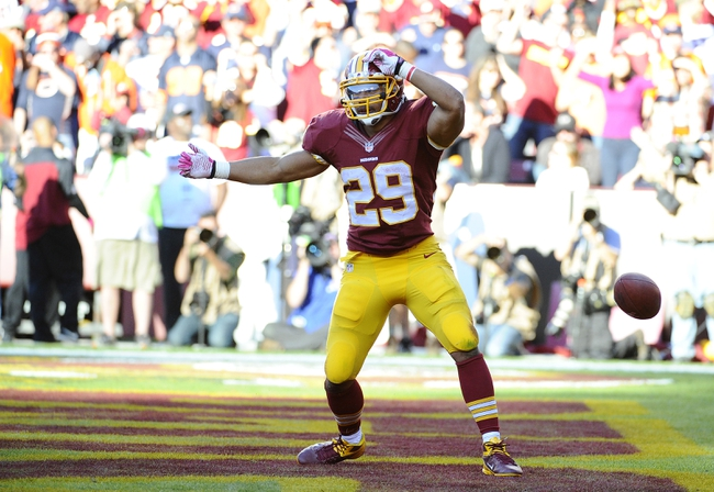 Oct 20, 2013; Landover, MD, USA; Washington Redskins running back Roy Helu (29) celebrates after scoring a touchdown against the Chicago Bears during the second half at FedEX Field. Mandatory Credit: Brad Mills-USA TODAY Sports