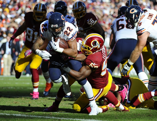 Oct 20, 2013; Landover, MD, USA; Chicago Bears running back Matt Forte (22) breaks the tackle of Washington Redskins linebacker London Fletcher (59) to score a touchdown during the second half at FedEX Field. Mandatory Credit: Brad Mills-USA TODAY Sports