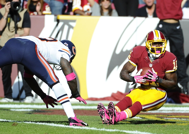 Oct 20, 2013; Landover, MD, USA; Washington Redskins wide receiver Aldrick Robinson (11) falls into the end zone after catching a touchdown pass against the Chicago Bears during the second half at FedEX Field. Mandatory Credit: Brad Mills-USA TODAY Sports