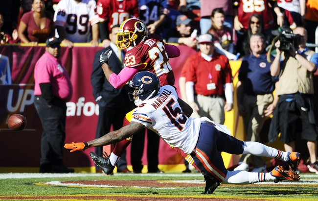 Oct 20, 2013; Landover, MD, USA; Washington Redskins cornerback DeAngelo Hall (23) breaks up a pass intended for Chicago Bears wide receiver Brandon Marshall (15) during the second half at FedEX Field. Mandatory Credit: Brad Mills-USA TODAY Sports