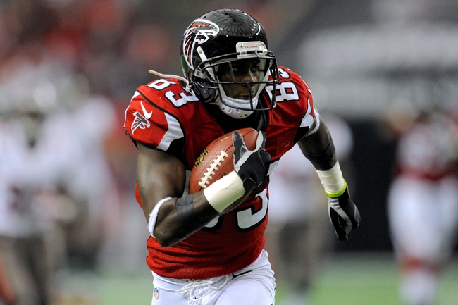 Oct 20, 2013; Atlanta, GA, USA; Atlanta Falcons wide receiver Harry Douglas (83) runs with the ball after a catch against the Tampa Bay Buccaneers during the first half at the Georgia Dome. The Falcons defeated the Buccaneers 31-23.  Mandatory Credit: Dale Zanine-USA TODAY Sports