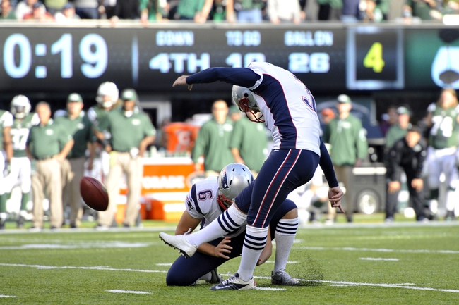 Oct 20, 2013; East Rutherford, NJ, USA; New England Patriots kicker Stephen Gostkowski (3) kicks the game-tying field goal against the New York Jets during the second half at MetLife Stadium. The Jets won the game 30-27 in overtime. Mandatory Credit: Joe Camporeale-USA TODAY Sports