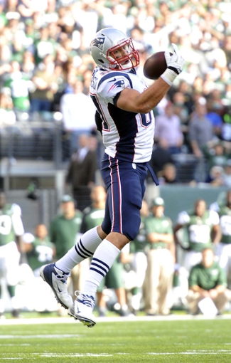 Oct 20, 2013; East Rutherford, NJ, USA; New England Patriots tight end Rob Gronkowski (87) is unable to make a catch against the New York Jets during the second half at MetLife Stadium. The Jets won the game 30-27 in overtime. Mandatory Credit: Joe Camporeale-USA TODAY Sports