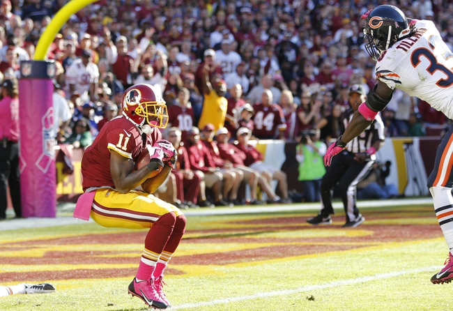 Oct 20, 2013; Landover, MD, USA; Washington Redskins wide receiver Aldrick Robinson (11) catches a touchdown pass behind Chicago Bears cornerback Charles Tillman (33) in the fourth quarter at FedEx Field. The Redskins won 44-41. Mandatory Credit: Geoff Burke-USA TODAY Sports
