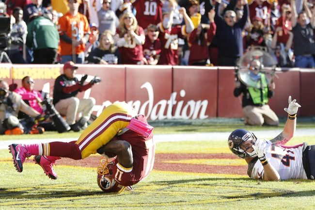 Oct 20, 2013; Landover, MD, USA; Washington Redskins wide receiver Aldrick Robinson (11) flips into the end zone after catching a touchdown pass in front of Chicago Bears free safety Chris Conte (47) in the fourth quarter at FedEx Field. The Redskins won 44-41. Mandatory Credit: Geoff Burke-USA TODAY Sports