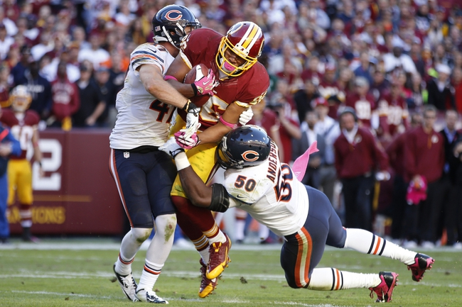 Oct 20, 2013; Landover, MD, USA; Washington Redskins tight end Jordan Reed (86) runs with the ball as Chicago Bears free safety Chris Conte (47) and Bears outside linebacker James Anderson (50) make the tackle in the fourth quarter at FedEx Field. The Redskins won 44-41. Mandatory Credit: Geoff Burke-USA TODAY Sports