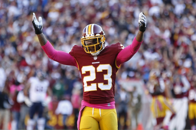 Oct 20, 2013; Landover, MD, USA; Washington Redskins cornerback DeAngelo Hall (23) celebrates on the field after the Redskins against the Chicago Bears at FedEx Field. The Redskins won 44-41. Mandatory Credit: Geoff Burke-USA TODAY Sports