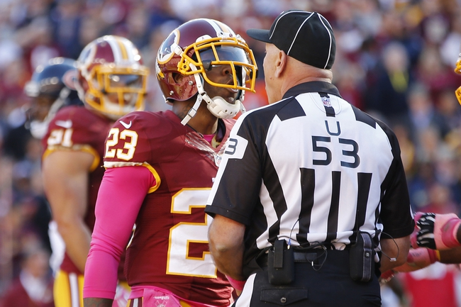 Oct 20, 2013; Landover, MD, USA; Washington Redskins cornerback DeAngelo Hall (23) argues a call with umpire Garth DeFelice (53) against the Chicago Bears in the fourth quarter at FedEx Field. The Redskins won 45-41. Mandatory Credit: Geoff Burke-USA TODAY Sports