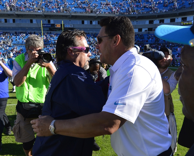 Oct 20, 2013; Charlotte, NC, USA; St. Louis Rams head coach Jeff Fisher with Carolina Panthers head coach Ron Rivera after the game. The Carolina Panthers defeated the St. Louis Rams 30-15 at Bank of America Stadium. Mandatory Credit: Bob Donnan-USA TODAY Sports