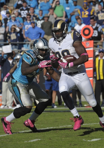 Oct 20, 2013; Charlotte, NC, USA; St. Louis Rams tight end Jared Cook (89) breaks the tackle of Carolina Panthers linebacker Thomas Davis (58) during the game at Bank of America Stadium. Panthers win 30-15. Mandatory Credit: Sam Sharpe-USA TODAY Sports