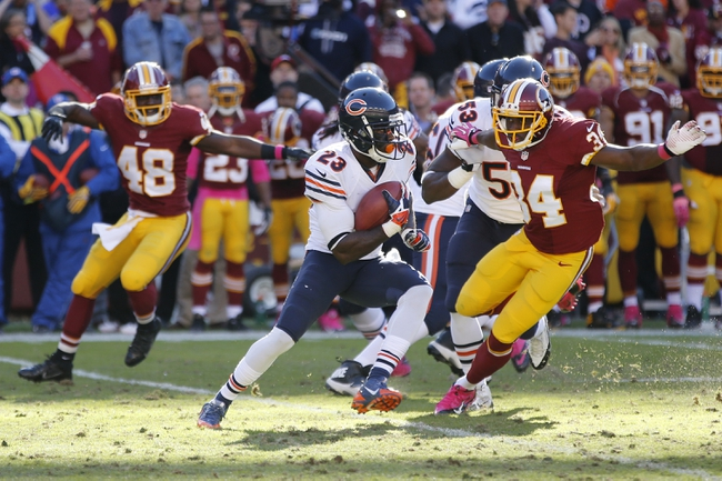 Oct 20, 2013; Landover, MD, USA; Chicago Bears wide receiver Devin Hester (23) runs with the ball past Washington Redskins defensive back Trenton Robinson (34) in the fourth quarter at FedEx Field. The Redskins won 45-41. Mandatory Credit: Geoff Burke-USA TODAY Sports