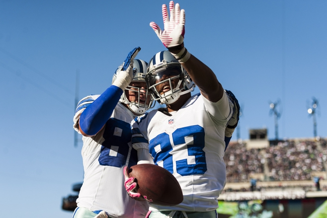 Oct 20, 2013; Philadelphia, PA, USA; Dallas Cowboys wide receiver Terrance Williams (83) celebrates scoring a touchdown with tight end Jason Witten (82) during the fourth quarter against the Philadelphia Eagles at Lincoln Financial Field. The Cowboys defeated the Eagles 17-3. Mandatory Credit: Howard Smith-USA TODAY Sports
