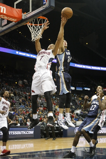 Oct 10, 2013; Atlanta, GA, USA; Atlanta Hawks shooting guard Jared Cunningham (7) is blocked by Memphis Grizzlies small forward Tony Gaffney (24) in the fourth quarter at Philips Arena. The Grizzlies defeated the Hawks 90-82. Mandatory Credit: Brett Davis-USA TODAY Sports