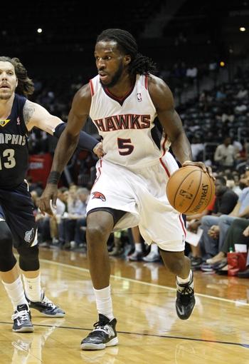 Oct 10, 2013; Atlanta, GA, USA; Atlanta Hawks small forward DeMarre Carroll (5) drives to the basket against the Memphis Grizzlies in the third quarter at Philips Arena. Mandatory Credit: Brett Davis-USA TODAY Sports