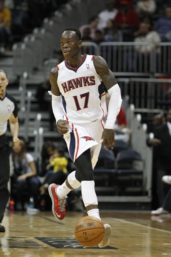 Oct 10, 2013; Atlanta, GA, USA; Atlanta Hawks point guard Dennis Schroder (17) brings the ball up court against the Memphis Grizzlies in the fourth quarter at Philips Arena. The Grizzlies defeated the Hawks 90-82. Mandatory Credit: Brett Davis-USA TODAY Sports