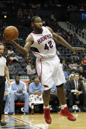 Oct 10, 2013; Atlanta, GA, USA; Atlanta Hawks power forward Elton Brand (42) saves a ball from going out of bounds against the Memphis Grizzlies in the fourth quarter at Philips Arena. The Grizzlies defeated the Hawks 90-82. Mandatory Credit: Brett Davis-USA TODAY Sports