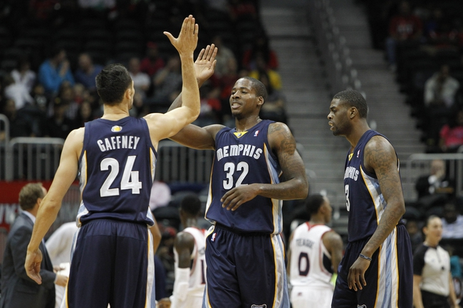 Oct 20, 2013; Atlanta, GA, USA; Memphis Grizzlies power forward Ed Davis (32) is congratulated by small forward Tony Gaffney (24) after a dunk against the Atlanta Hawks in the fourth quarter at Philips Arena. The Grizzlies defeated the Hawks 90-82. Mandatory Credit: Brett Davis-USA TODAY Sports