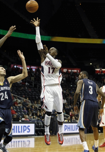 Oct 10, 2013; Atlanta, GA, USA; Atlanta Hawks point guard Dennis Schroder (17) shoots the ball against the Memphis Grizzlies in the fourth quarter at Philips Arena. The Grizzlies defeated the Hawks 90-82. Mandatory Credit: Brett Davis-USA TODAY Sports
