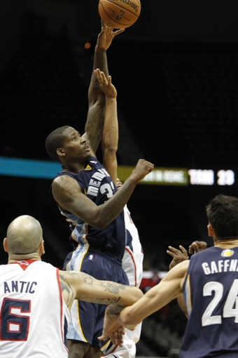 Oct 20, 2013; Atlanta, GA, USA; Memphis Grizzlies power forward Ed Davis (32) controls a jump ball against the Atlanta Hawks in the fourth quarter at Philips Arena. The Grizzlies defeated the Hawks 90-82. Mandatory Credit: Brett Davis-USA TODAY Sports
