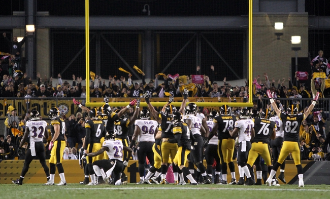Oct 20, 2013; Pittsburgh, PA, USA; The Pittsburgh Steelers celebrate the game-winning field goal by kicker Shuan Suisham (6) against the Baltimore Ravens during the second half at Heinz Field. The Steelers won the game, 19-16. Mandatory Credit: Jason Bridge-USA TODAY Sports