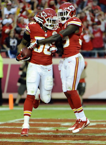 Oct 20, 2013; Kansas City, MO, USA; Kansas City Chiefs inside linebacker Derrick Johnson (56) celebrates with defensive back Husain Abdullah (39) after recovering a fumble against the Houston Texans in the second half at Arrowhead Stadium. The Chiefs won 17-16. Mandatory Credit: John Rieger-USA TODAY Sports