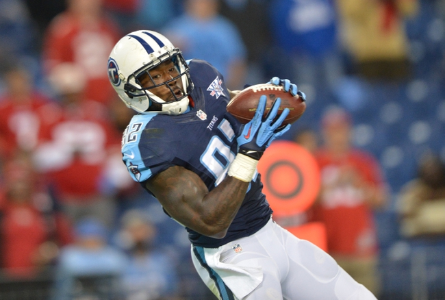 Oct 20, 2013; Nashville, TN, USA; Tennessee Titans tight end Delanie Walker (82) catches a pass for a touchdown against the San Francisco 49ers during the second half at LP Field. The 49ers beat the Titans 31-17. Mandatory Credit: Don McPeak-USA TODAY Sports