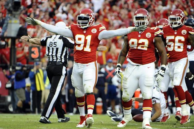 Oct 20, 2013; Kansas City, MO, USA; Kansas City Chiefs outside linebacker Tamba Hali (91) celebrates after sacking Houston Texans quarterback Case Keenum (7) in the second half at Arrowhead Stadium. The Chiefs won 17-16. Mandatory Credit: John Rieger-USA TODAY Sports