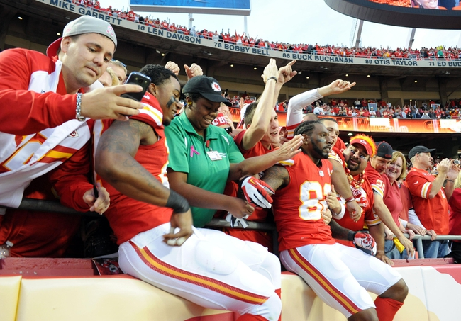 Oct 20, 2013; Kansas City, MO, USA; Kansas City Chiefs cornerback Sean Smith (27) and wide receiver Dwayne Bowe (82) celebrate with fans after the game against the Houston Texans at Arrowhead Stadium. The Chiefs won 17-16. Mandatory Credit: John Rieger-USA TODAY Sports
