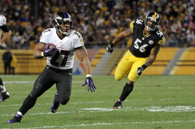 Oct 20, 2013; Pittsburgh, PA, USA; Baltimore Ravens running back Ray Rice (27) runs the ball past Pittsburgh Steelers linebacker LaMarr Woodley (56) during the second half at Heinz Field. The Steelers won the game, 19-16. Mandatory Credit: Jason Bridge-USA TODAY Sports